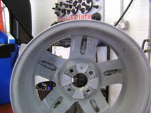 The same alloy wheel, now straightened